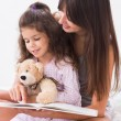 Stock Photo: Mother and daughter reading storybook