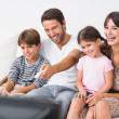 Happy family watching television — Stock Photo #24114083