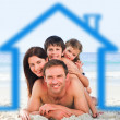 Family on the beach with blue house illustration - Stock Photo