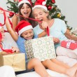 Happy family at christmas opening gifts together — Stock Photo