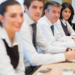 Smiling business in a row — Stock Photo