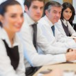 Stock Photo: Smiling business in row