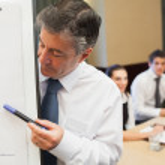 Businessman looking at his presentation — Stock Photo