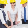 Archtects looking at construction plan — Stockfoto