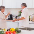 Old couple yelling in the kitchen — Stock Photo #24115793