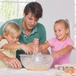 Stock Photo: Children mixing dough