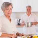 Old lovers preparing food — Stock Photo #24115907