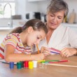 Child drawing with her grandmother — Stock Photo #24115927