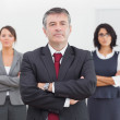 Businessman and his team standing — Stock Photo
