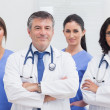 Two doctors and two nurses — Stock Photo