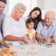 Happy family baking together — Stockfoto