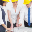 Architects looking at plan — Foto Stock
