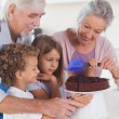 Children icing a cake in the kitchen — Stock Photo #24116307