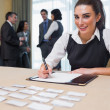 Happy woman at welcome desk — Stock Photo