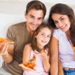 familjen äta pizza — Stockfoto #24116461