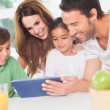 Family using a tablet pc - Stockfoto