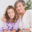 Portrait of a little girl and her grandmother - Stock Photo