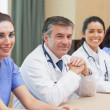 Smiling panel of doctors and nurses — Stock Photo