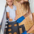 Daughter taking a cookie — Stock Photo