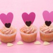 Three valentines cupcakes with heart decorations — Stock Photo