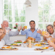 Happy family toasting at thanksgiving dinner — Stock Photo