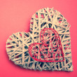 Wicker heart ornament with heart shaped box — Stock Photo