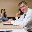 Happy businessman at meeting - Stock Photo
