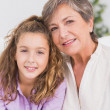 Portrait of a child and her grandmother - Stock Photo
