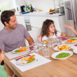 Family talking around the dinner table — Stock Photo