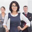 Smiling businesswoman and her team — Stock Photo