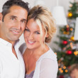 Couple embracing at christmas — Stock Photo