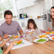Stock Photo: Family laughing around good meal