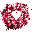 Pink confetti in inverted heart shape — Stock Photo