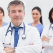 Doctor and his team smiling — Stock Photo #24117303