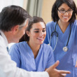 Doctor and nurses looking at laptop — Stock Photo