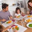 Family eating healthy dinner — Stock Photo