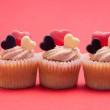 Three valentines cupcakes in a row — Stock Photo #24117631
