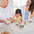Women of a family baking together — Stock Photo