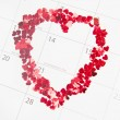 Confetti heart shape marking valentines day — Stock Photo