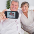Old man taking a picture of him and his wife — Stock Photo