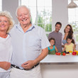Grandparents in front of their family — Stock Photo #24118069