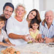 Smiling family baking together — Foto de Stock