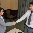 Business shaking hands at meeting — Stock Photo