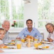 Family smiling at thanksgiving — Stock Photo #24118419