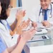 Nurses applauding a doctor — Stock Photo