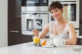 Woman having breakfast — Stock Photo