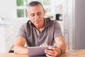 Happy man using tablet — Stok fotoğraf