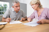 Couple discussing with documents — Stock Photo
