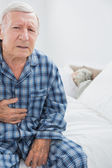 Aged man suffering with body pain — Stock Photo