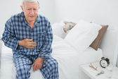 Elderly man suffering with belly pain — Stock Photo